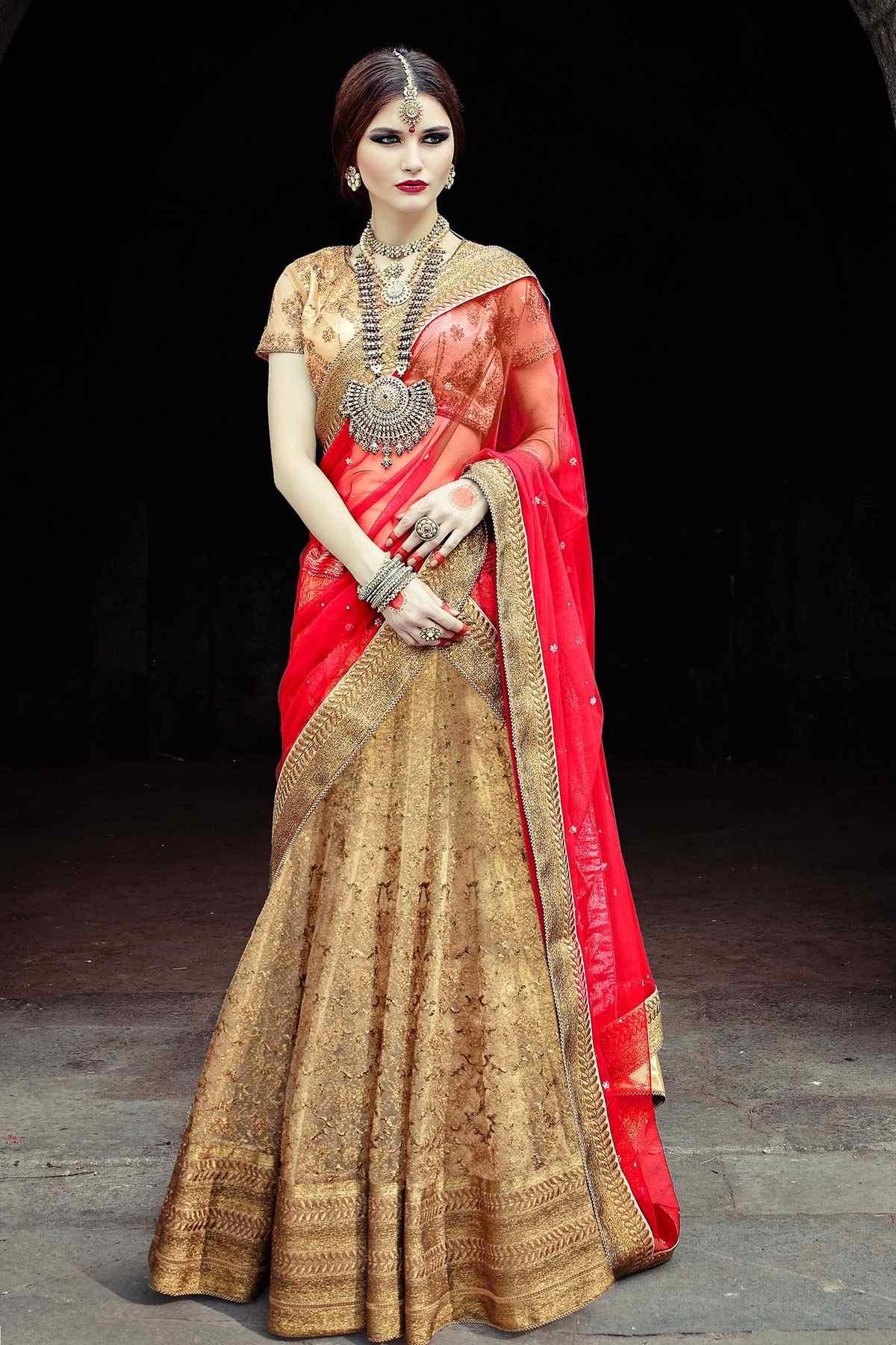 lehenga golden choli flared bridal gold designer designs embroideried overflowing gajiwala